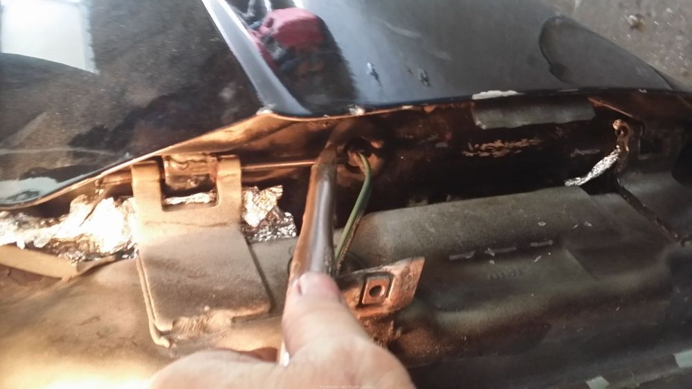 Changing dodge Shelby charger door hinge pins.